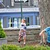 Ryan Olivier-Meehan, 9, right, and his younger brother Cole, 7, throw paper airplanes across the yard at the Manchester Public Library after the library's second Annual Paper Airplane Contest on Thursday afternoon. Jesse Poole/Gloucester Daily Times April 26, 2012