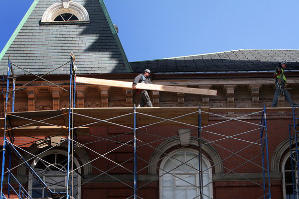 ALLEGRA BOVERMAN/Staff photo. Gloucester Daily Times. Gloucester: Scaffolding is being installed at City Hall in Gloucester in preparation for a restoration project.
