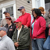 ALLEGRA BOVERMAN/Staff photo. Gloucester Daily Times. Gloucester: Members of the Harrison family at a press conference they held at their home in Gloucester on Wednesday afternoon. At bottom left is David Harrison, Jr. Behind him in the second row, center is Anthony Harrison, father of missing toddler Caleigh Harrison, next to him at right is Allison Hammond, Caleigh's mother. With his hands on Anthony's shoulders is David Harrison, Sr., Caleigh's paternal grandfather. They are surrounded by other Harrison family members.