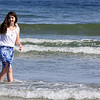ALLEGRA BOVERMAN/Staff photographer. Gloucester Daily Times. Gloucester: Izzy Schmidt, 13, of Concord, wades in the water while visiting Good Harbor Beach on Tuesday with her family.