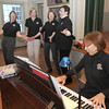 "Gloucester: Hiedi Dallin plays piano as from the left: Francis Fleming, Katzi Rueda, Kate Van Demark and Jackie Gravell sing ""My sister Kate"" during  a""Share the Music"" rehearsal at Annisquam Town Hall. Jim Vaiknoras/staff photo"