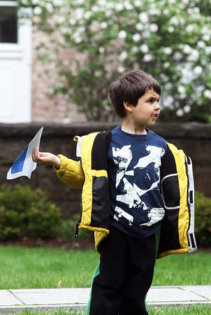 Davide Bussone, 4, of Manchester, gets ready to toss his homemade paper airplane in the Manchester Public Library's second Annual Paper Airplane Contest on Thursday afternoon. Jesse Poole/Gloucester Daily Times April 26, 2012