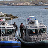 ALLEGRA BOVERMAN/Staff photo. Gloucester Daily Times. Rockport: State environmental police were helping to search the waters of Long Beach in Rockport on Friday. They were coming into the Old Granite Pier area to confer with State Police Marine Unit personnel at left. The Marine Unit and its divers were based at the Old Granite Pier.