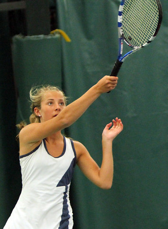 ALLEGRA BOVERMAN/Staff photo. Gloucester Daily Times. Manchester: Triton's third singles player KaleyT owns in action against Manchester-Essex's captain Eliza Rhoner, a senior, during their match at Manchester Athletic Club on Monday.