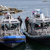 ALLEGRA BOVERMAN/Staff photo. Gloucester Daily Times. Rockport: State environmental police were helping to search the waters of Long Beach in Rockport on Friday. They were coming into the Old Granite Pier area to confer with State Police Marine Unit personnel at left.