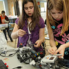 ALLEGRA BOVERMAN/Staff photo. Gloucester Daily Times. Rockport: McKenna Parker, right, and Sophie Renda, center, both Rockport Elementary School fourth graders, work on their robots during the Robotics Club meeting on Monday afternoon at the school. The club is new to the school this academic year and runs for 6-7 weeks at a time. It is run by volunteer and engineer Eric Wilson who works at Varian in Gloucester. Varian donated several laptops and matched donations to the club. Fifth grader Zak Poretta is at far left.