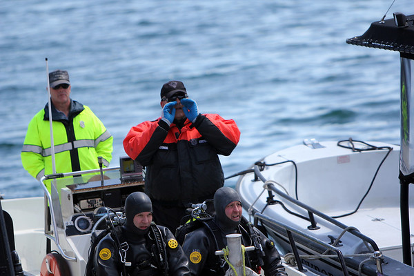 ALLEGRA BOVERMAN/Staff photo. Gloucester Daily Times. Rockport: The search for Caleigh Harrison continues in the Cape Hedge Beach and Long Beach areas of Rockport on Wednesday. State Police marine unit divers ready to set out again after a quick break for lunch on Wednesday.