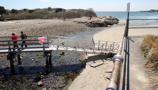 ALLEGRA BOVERMAN/Staff photo. Gloucester Daily Times. Rockport: Balloons have been placed on the footbridge over Saratoga Creek that joins Long Beach and Cape Hedge Beaches. Caleigh Harrison, 2 1/2, went missing in this vicinity last week. This view is from up on the boardwalk.