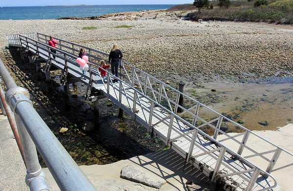 ALLEGRA BOVERMAN/Staff photo. Gloucester Daily Times. Rockport: Balloons have been placed on the footbridge over Saratoga Creek that joins Long Beach and Cape Hedge Beaches. Caleigh Harrison, 2 1/2, of Gloucester, went missing in this vicinity last week. This view is from the boardwalk above.