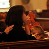 ALLEGRA BOVERMAN/Staff photo. Gloucester Daily Times. Gloucester: Leslie McCaddon is comforted during the funeral for her husband, Capt. Michael Ryan McCaddon, M.D. on Tuesday at St. Ann Church.