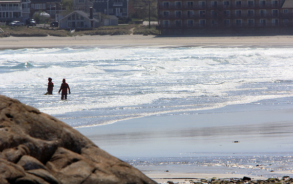 ALLEGRA BOVERMAN/Staff photo. Gloucester Daily Times. Rockport: U.S. Coast Guard personnel were searching in the Long Beach waters for Caleigh Harrison, 2 1/2, of Gloucester who went missing on the Rockport side of the beach on Thursday.