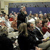 Manchester: Austin O'Keefe asks a question at Manchester's Annual towm meeting at the Manchester Memorial Elementary School Monday night. Jim Vaiknmoras/staff photo