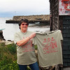 "Barbara Jobe of Lanesville sports a new T-shirt disigned to raise both finances and awareness for an effort to restore the historic Scandinavian shack at Lane's Cove. It depicts the shack itself and states above the image, ""S.O.S. Save Our Shack."" These shirts are available for purchase at Woola on Washington Street in Lanesville. Jesse Poole/Gloucester Daily Times April 12, 2012"