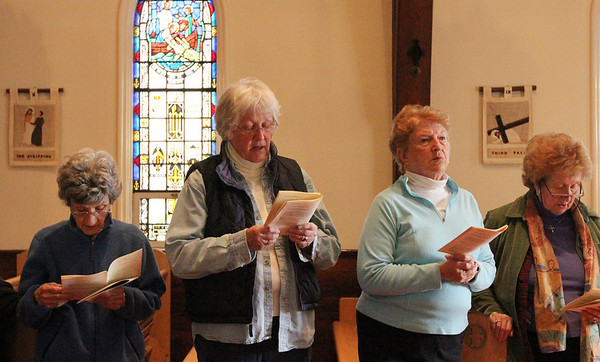 ALLEGRA BOVERMAN/Staff photo. Gloucester Daily Times. Gloucester: During The Way of the Cross service inside the St. John's Episcopal Church sanctuary on Friday. The Rev. Bret Hays presided.