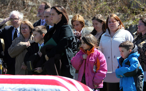 ALLEGRA BOVERMAN/Staff photo. Gloucester Daily Times. Gloucester: Family and friends of Capt. Michael Ryan McCaddon, M.D. at his graveside service with full military honors on Tuesday at Calvary Cemetery.