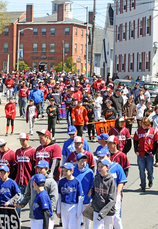The Gloucester Little League Parade marches down toward the boulevard on Saturday morning. Jesse Poole/Gloucester Daily Times April 38, 2012