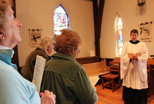 ALLEGRA BOVERMAN/Staff photo. Gloucester Daily Times. Gloucester: During The Way of the Cross service inside the St. John's Episcopal Church sanctuary on Friday, at the Eighth Station, where Jesus meets the weeping women of Jerusalem. The Rev. Bret Hays presided.