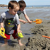 ALLEGRA BOVERMAN/Staff photographer. Gloucester Daily Times. Gloucester: Joshuah, 3, and his brother Isaiah, 7, Forget, both of Lunenburg, play together in the sand while visiting Good Harbor Beach on Tuesday with their family.