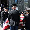 ALLEGRA BOVERMAN/Staff photo. Gloucester Daily Times. Gloucester: <br /> Capt. Michael Ryan McCaddon, M.D. was given full military honors for his funeral at St. Ann Church and Cavalry Cemetery on Tuesday. His family looks on at far left.