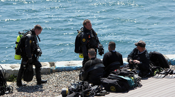 ALLEGRA BOVERMAN/Staff photo. Gloucester Daily Times. Rockport: The search for Caleigh Harrison continues in the Cape Hedge Beach and Long Beach areas of Rockport on Wednesday. State Police marine unit divers Sean Maloney, left, and Sgt. Dave Mahon, walking, return from their dive.