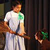 Carlie Goulart, playing Dorothy in Beeman Memorial Elementary School's production of The Wizard of Oz on Friday afternoon, extends her hand to her trusty sidekick Toto, played by Marissa Alves. Jesse Poole/Gloucester Daily Times April 13, 2012
