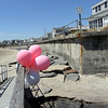 ALLEGRA BOVERMAN/Staff photo. Gloucester Daily Times. Rockport: Balloons have been placed on the footbridge over Saratoga Creek that joins Long Beach and Cape Hedge Beaches. Caleigh Harrison, 2 1/2, of Gloucester went missing in this vicinity last week.