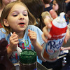 A very excited Kaitlen Harding, first grade, watches as her bowl of vanilla icecream is topped off with whipped cream at Essex Elementary School on Friday afternoon. Jesse Poole/Gloucester Daily Times April 13, 2012
