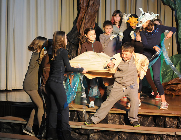 "Gloucester:The North Wind played by Emily Frick, and the Sun played Aurelio Silva fight over Liam Donahue as the Traveler in ""The Enchanted Oak"" play at Plum Cove Elementary School Thursday. The play performed by the 4th and 5th grader at the school,is a collection of short stories directed by Jill Rogati and Nate Punches. Funded partly by the Gloucester Education Foundation."