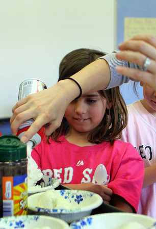 First-grader Aby Whittemore awaits her bowl of ice cream at Essex Elementary School on Friday afternoon. Jesse Poole/Gloucester Daily Times April 13, 2012