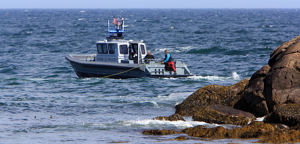 ALLEGRA BOVERMAN/Staff photo. Gloucester Daily Times. Gloucester: Massachusetts State Police dive teams were searching in the choppy, cold waters of Long Beach in Rockport on Friday for Caleigh Harrison, 2 1/2, of Gloucester, who went missing on Thursday.