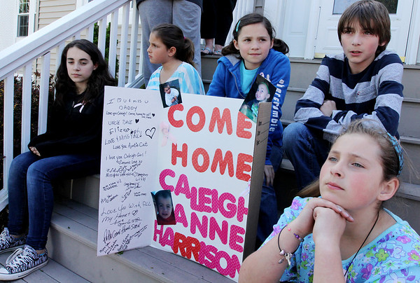ALLEGRA BOVERMAN/Staff photo. Gloucester Daily Times. Gloucester: Cousins of missing toddler Caleigh Harrison have created a poster in her honor. From left to right at the Harrison family home on Friday are: Brianna Fernandez, 12, Angelena Curcuru, 7, Julia Harrison, 10, Colin Harrison, 12, and Sabella Curcuru, 10, all of Gloucester.