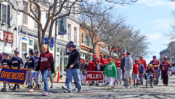 Team after team marched down Main Street toward Stage Fort Park on Saturday morning as part of the Gloucester Little League Parade. Jesse Poole/Gloucester Daily Times April 28, 2012