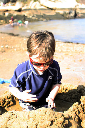 Drew Chovinard, 5, of Gloucester visits Half Moon Beach at Stage Fort Park with his mom and he builds a fort with the abundance of sand and water. Jesse Poole/Gloucester Daily Times April 16, 2012