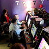 ALLEGRA BOVERMAN/Staff photo. Gloucester Daily Times. Gloucester: Lucky 7 Arcade Manager Janine Brooks, far left, helps Carol Sylvain and Joanne White, both of Gloucester, to use the arcade's new machines on Wednesday. Brooks' parents, the owners, have opened another location at the Liberty Tree Mall.