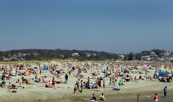 Good Harbor Beach fills up with beach-goers early Monday morning. Jesse Poole/Gloucester Daily Times April 16, 2012