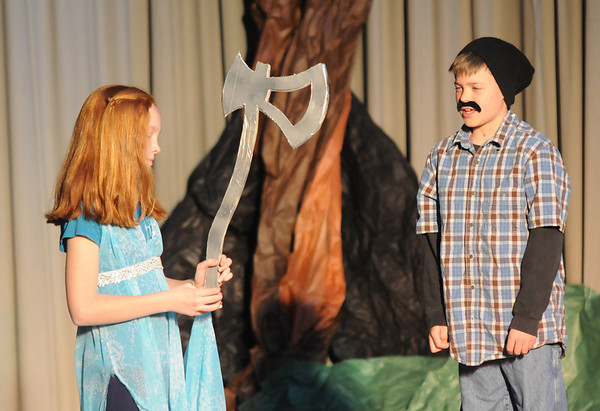 "Gloucester: Courtney Good as the Mermade and Albert Pereira as the Woodsman in ""The Enchanted Oak"" play at Plum Cove Elementary School Thursday. The play performed by the 4th and 5th grader at the school,is a collection of short stories directed by Jill Rogati and Nate Punches. Funded partly by the Gloucester Education Foundation."
