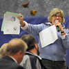 Manchester: Betsy Cross asks a question about trash revenues Manchester's Annual towm meeting at the Manchester Memorial Elementary School Monday night. Jim Vaiknmoras/staff photo
