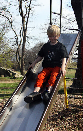 Mason Gumniz, 6, enjoys the slide at Stage Fort Park on Monday afternoon. Jesse Poole/Gloucester Daily Times April 16, 2012