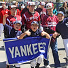 The Yankees pose as they reach Boudreau Field and the Gloucester Little League Parade, which started at Burnham's field, ends on Saturday morning. Jesse Poole/Gloucester Daily Times APril 28, 2012