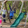 ALLEGRA BOVERMAN/Staff photo. Gloucester Daily Times. Gloucester: Lizzy Harrison, far left, 4, of Gloucester, plays in her backyard on Friday afternoon with cousins Sabella Curcuru, 10, center back, and Julia Harrison, 10, both also of Gloucester.