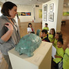 Gloucester:Liza Browning shows a sculpture by Paul Manship to students at Pathways for Children Head Start program as part of the  Cape Ann Museum's Young at Art program. The kids ages 2-5 particpated in a visual scavanger hunt, learned about sculpture and make some of their own. Jim Vaiknoras/staff photo
