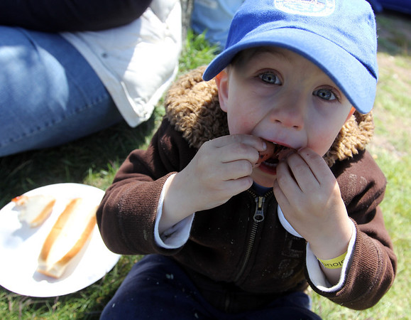 ALLEGRA BOVERMAN/Staff photo. Gloucester Daily Times. Gloucester: About 400 people walked in the 25th Annual Pride Stride through Gloucester on Sunday. At the community cookout, Frankie Fornero, 3, of Gloucester, stuffs his mouth full of hot dogs, after walking in the fundraiser with his mom.