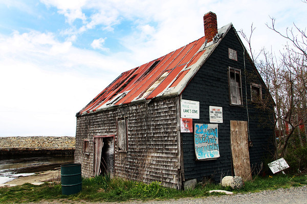 A group of Lanesville residents are calling for the restoration of the historic Scandinavian fish shack at Lanes Cove. T-shirts depicting the shack are available for purchase at Woola on Washington Street in Lanesville. Jesse Poole/Gloucester Daily Times April 12, 2012