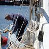 """ALLEGRA BOVERMAN/Staff photographer. Gloucester Daily Times. Gloucester: Ron Riley of Gloucester fixes the rail on his lobster boat, """"My Girls II,"""" at the city wharf at the 1-4, C-2 site on Monday morning."""