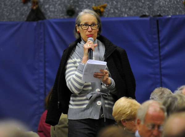 Manchester: Wendy Dixon asks a question about DPW funding at Manchester's Annual towm meeting at the Manchester Memorial Elementary School Monday night. Jim Vaiknmoras/staff photo
