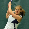 ALLEGRA BOVERMAN/Staff photo. Gloucester Daily Times. Manchester: Triton's first singles player Sydney White in action against Manchester-Essex's Michelle Fuca during their match at Manchester Athletic Club on Monday.