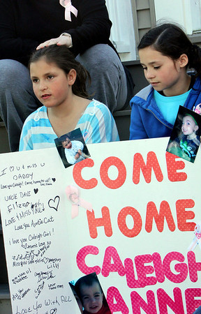 ALLEGRA BOVERMAN/Staff photo. Gloucester Daily Times. Gloucester: Cousins of missing toddler Caleigh Harrison have created a poster in her honor. From left, cousins Angelena Curcuru, 7, and Julia Harrison, 10, both of Gloucester, talk about their little cousin.