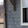 ALLEGRA BOVERMAN/Staff photo. Gloucester Daily Times. Rockport: A home on South Street next to Cape Hedge Beach has a candle in a window as requested by family of missing toddler Caleigh Harrison as a way of showing support and hope for her in the search.
