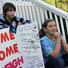 ALLEGRA BOVERMAN/Staff photo. Gloucester Daily Times. Gloucester: Cousins of missing toddler Caleigh Harrison have created a poster in her honor. From left are two of her cousins talking about her: Colin Harrison, 12, and Sabella Curcuru, 10, both of Gloucester.