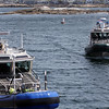 ALLEGRA BOVERMAN/Staff photo. Gloucester Daily Times. Rockport: State environmental police, in the boat at right, were helping to search the waters of Long Beach in Rockport on Friday. They were coming into the Old Granite Pier area here to confer with State Police Marine Unit personnel.